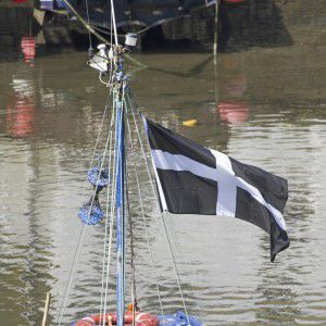Fishing boat flying the Cornwall flag of St Piran